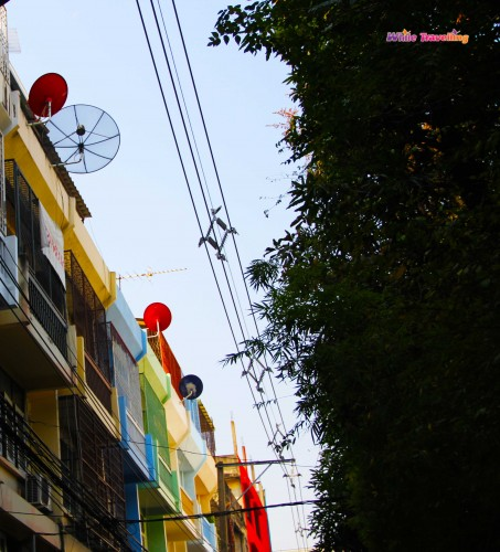 The colorful buildings and satellite dishes in Bangkok, Thailand