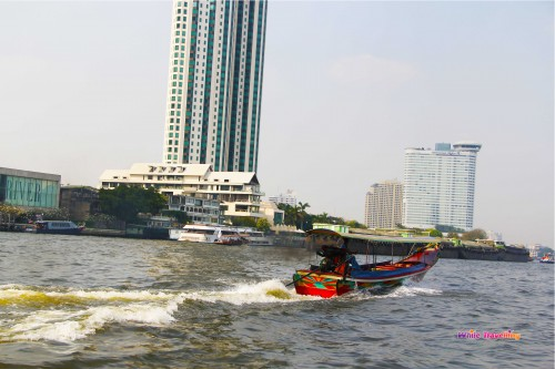 A long tail boat on the Chao Phraya River in Bangkok