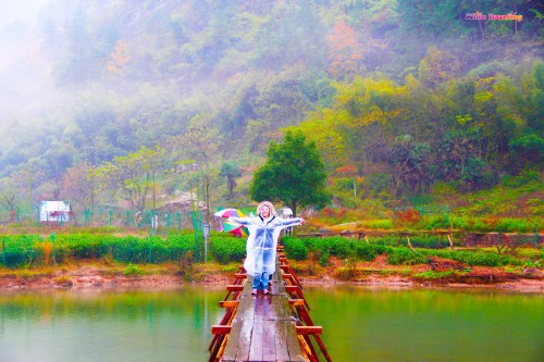 Walking on the wooden bridge in Xinchang